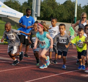 Photo 6 YES Junior Coach Mohammed helping to run relays at YES Track and Field